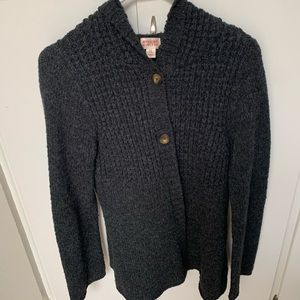 Gray button up sweater.